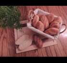 Norma Najacht is spending her time at home making vienna rolls.